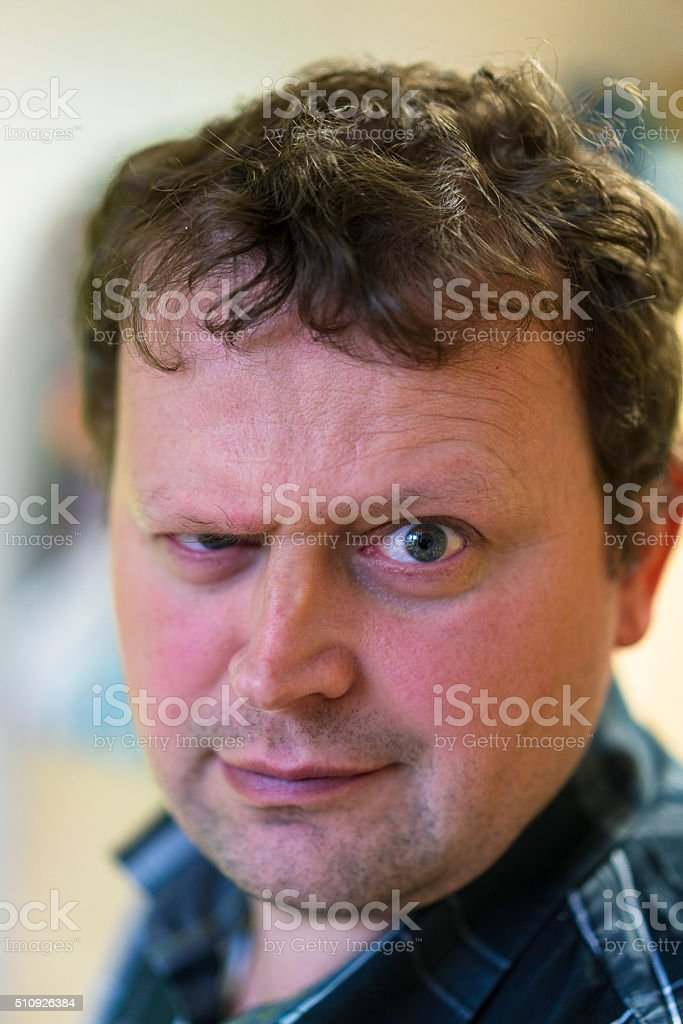Portrait of an man with angry and big eye stock photo
