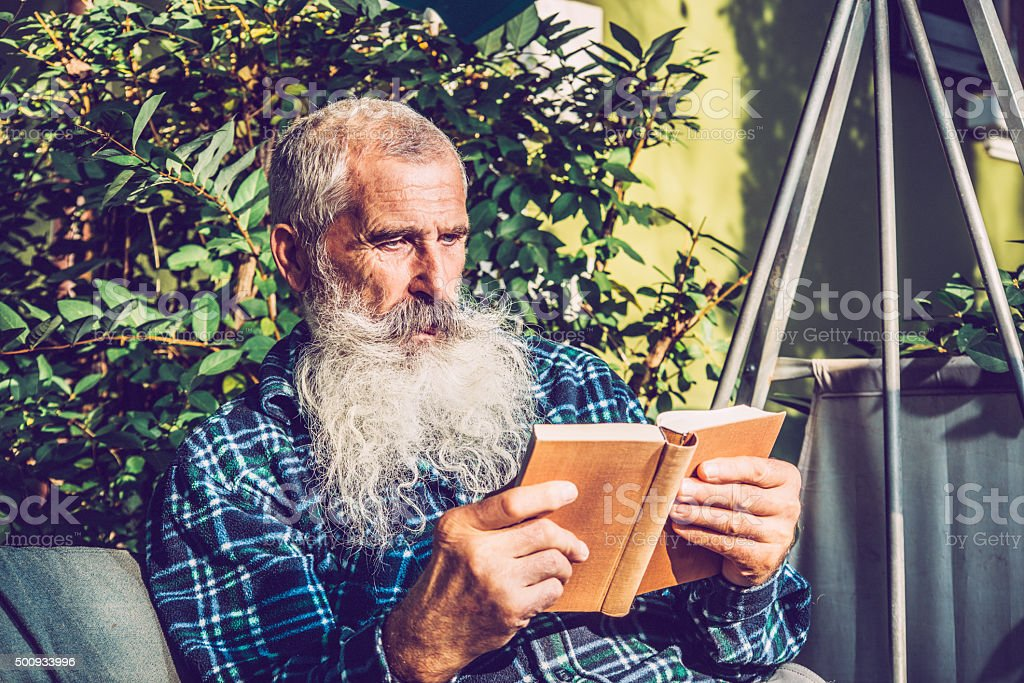 Portrait of an Old Man with Extremely Long Beard Outdoors stock photo