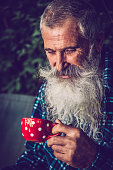 Portrait of an Old Man with Extremely Long Beard Outdoors