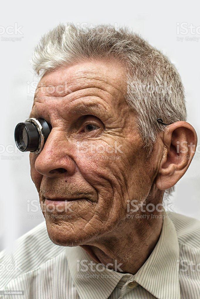 portrait of an old men witn eyeglasses stock photo
