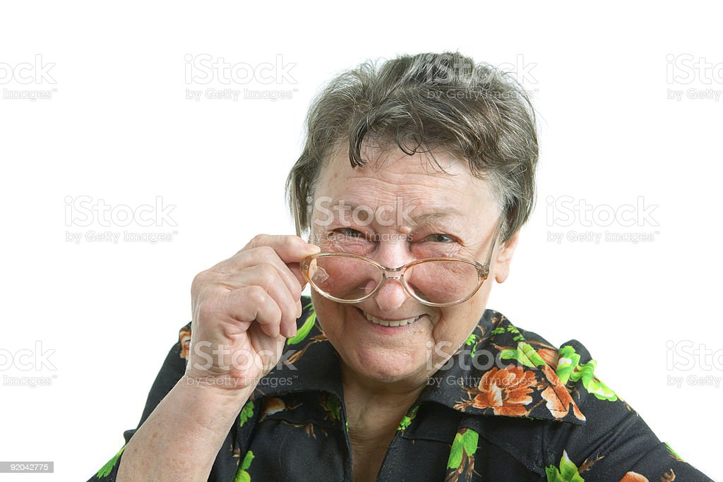 portrait of an old smiling woman wearing glasses royalty-free stock photo