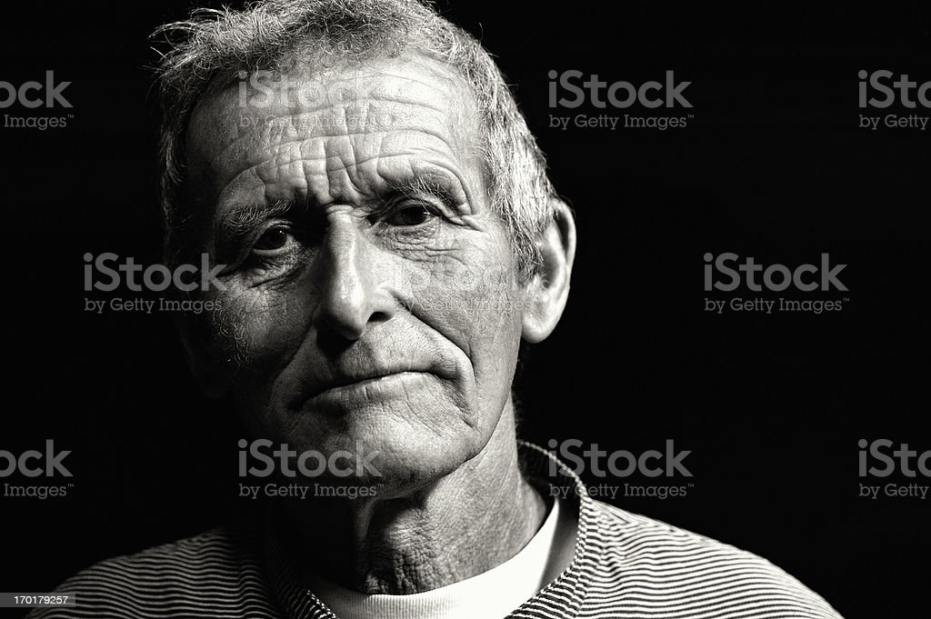 Portrait of an Old Swiss Dairy Farmer in Traditional Clothing stock photo