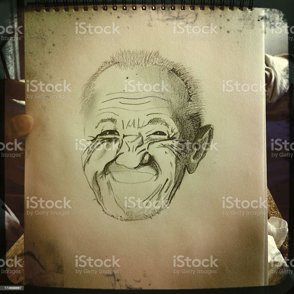 Portrait of an Smiling Elder Man on Notebook royalty-free stock photo