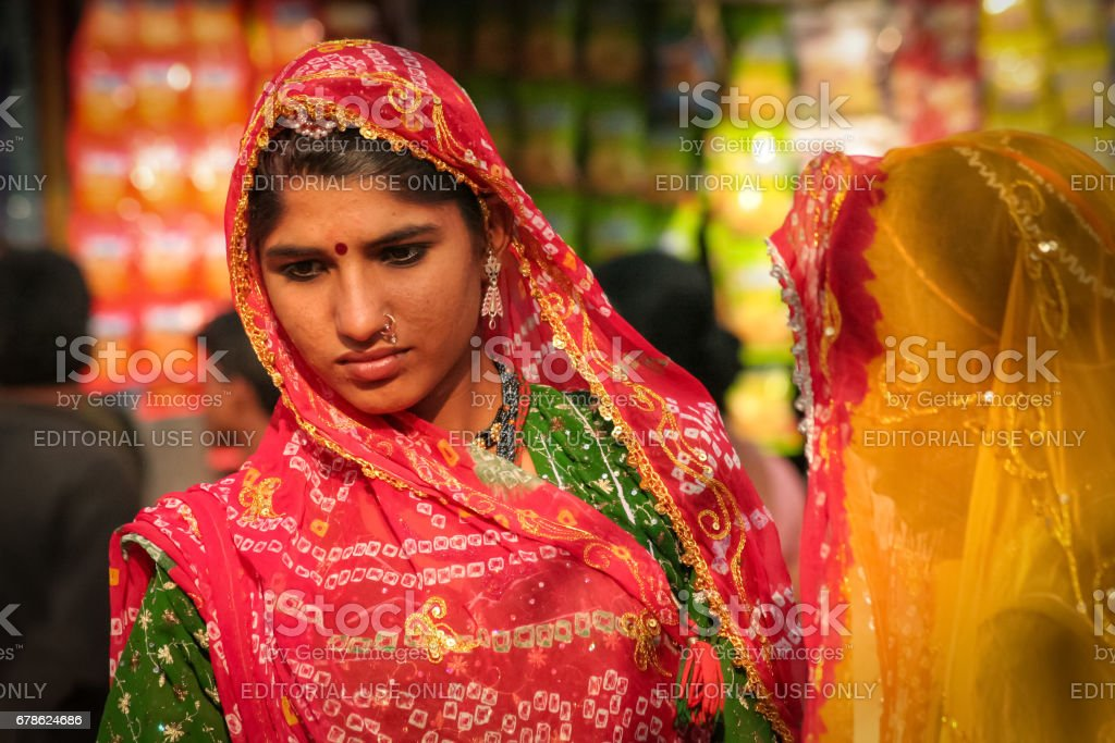 Portrait of an unidentified beautiful Indian woman dressed in typical Rajasthani colorful and vibrant attire at Pushkar Camel Fair stock photo