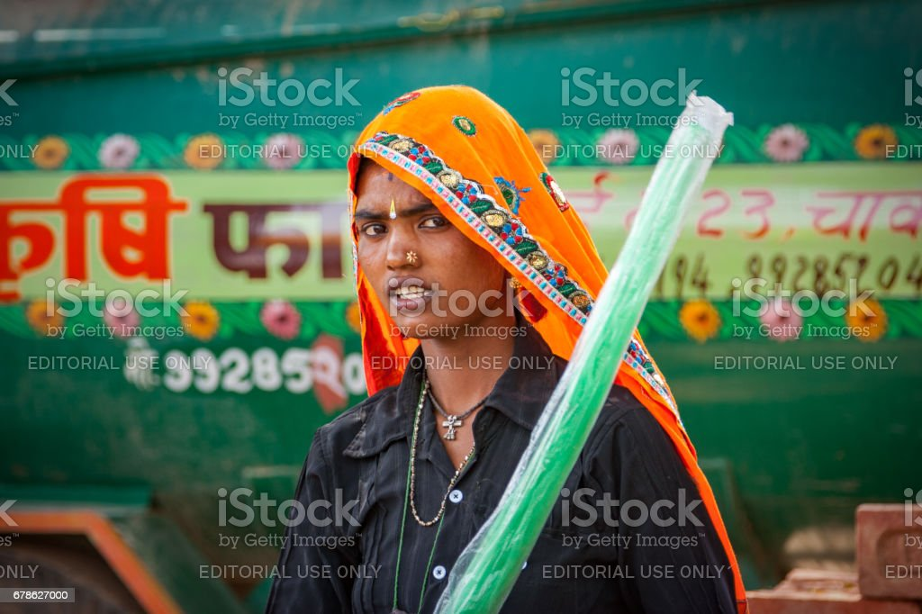 Portrait of an unidentified Indian nomadic woman dressed in typical Rajasthani attire at Chaksu Fair stock photo