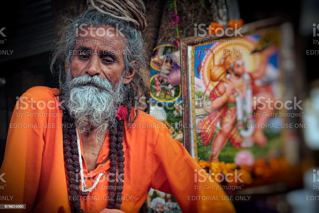 Portrait of an unidentified Indian sadhu (holy man) near holy Pushkar Sarovar (lake) at Pushkar stock photo