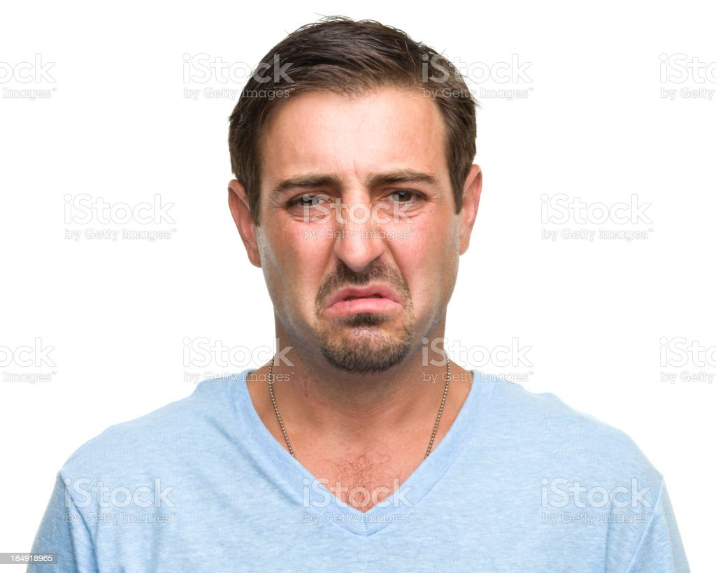 Portrait of an upset man making a disgusted face stock photo