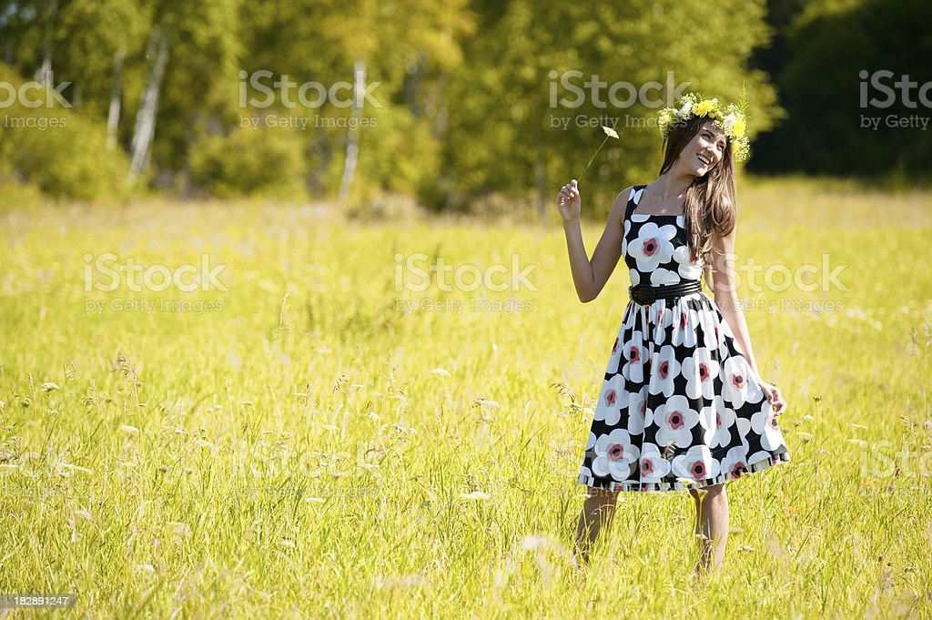 Portrait of an young beautiful woman on the nature royalty-free stock photo