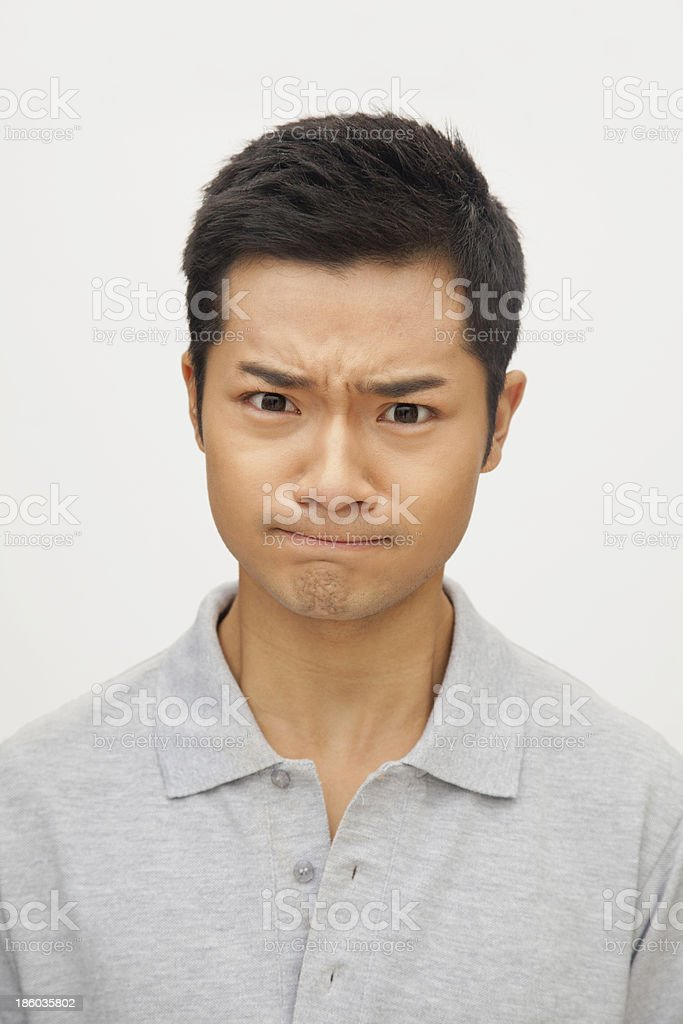 Portrait of angry and frustrated young man, studio shot royalty-free stock photo