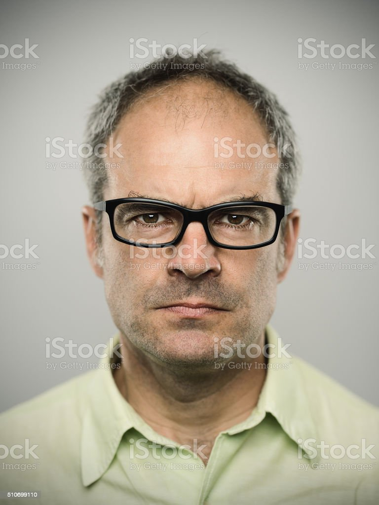 Portrait of angry caucasian real man stock photo