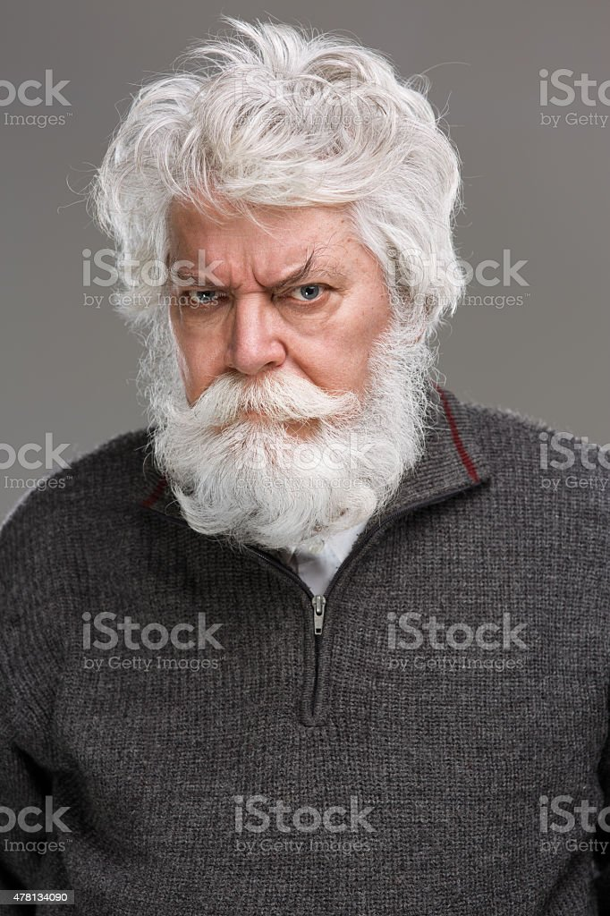 Portrait of angry senior man with white beard and mustache stock photo