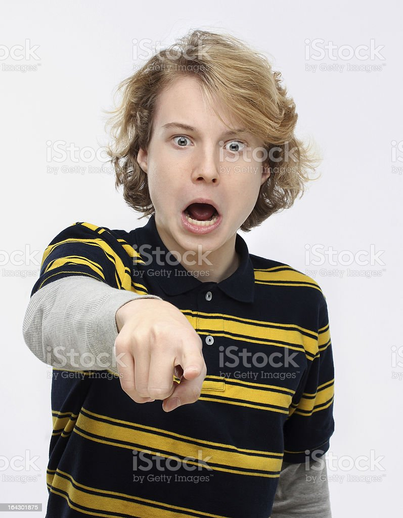 Portrait of  angry teenage boy pointing at the camera. royalty-free stock photo