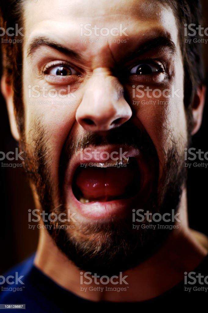 Portrait of Angry Young Man Yelling stock photo
