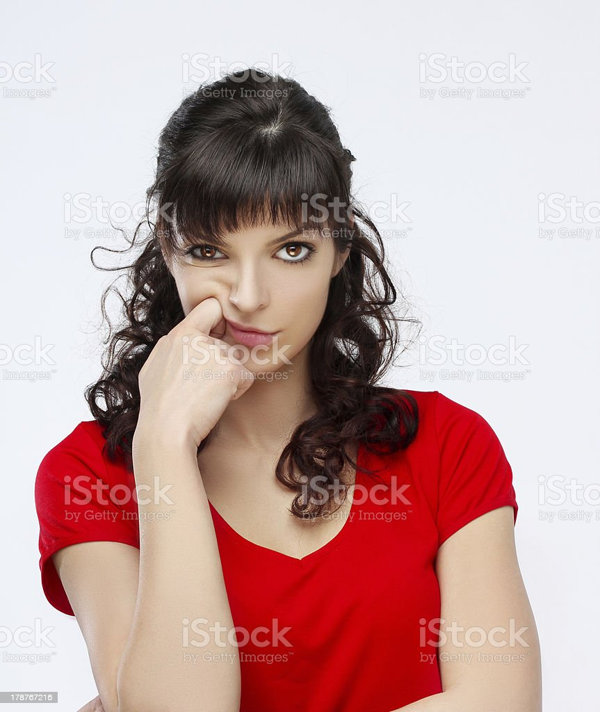 Portrait of angry young woman staring at the camera. royalty-free stock photo