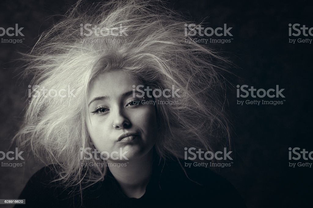 Portrait of annoyed girl with wild hair stock photo