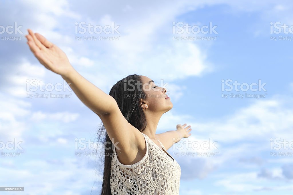 Portrait of arab woman breathing fresh air with raised arms stock photo