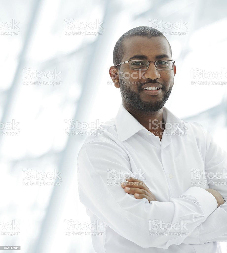 Portrait of Arabic businessman with glasses and arms crossed stock photo