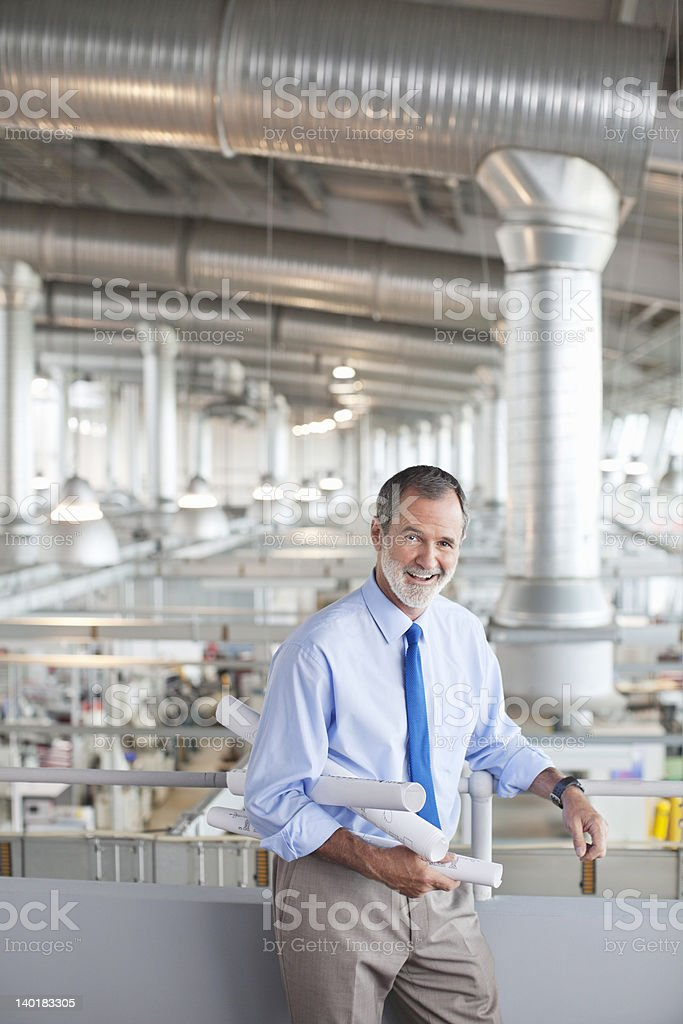 Portrait of architect with blueprints factory royalty-free stock photo