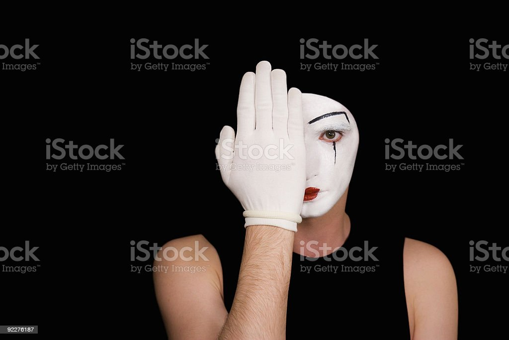 Portrait of artful peeping mime in white gloves royalty-free stock photo