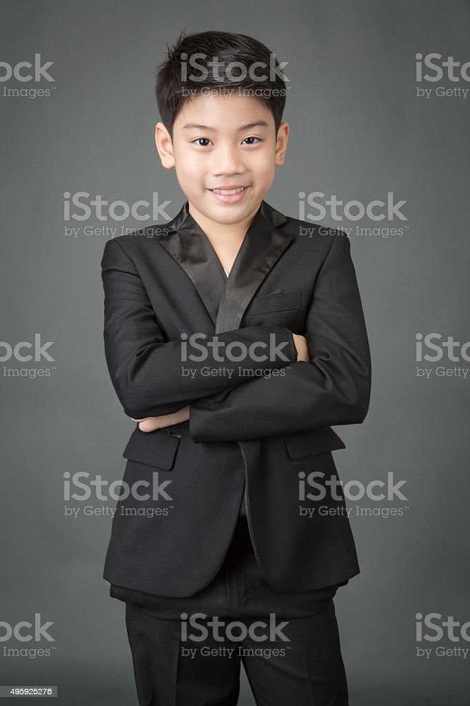 Portrait of asian boy in a Business Suit, stock photo
