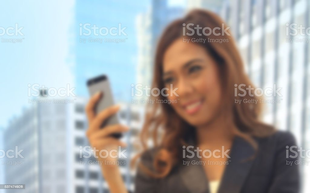 Portrait of Asian business woman on black dress use moblie stock photo