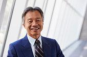 Portrait Of Asian Businessman In Modern Office