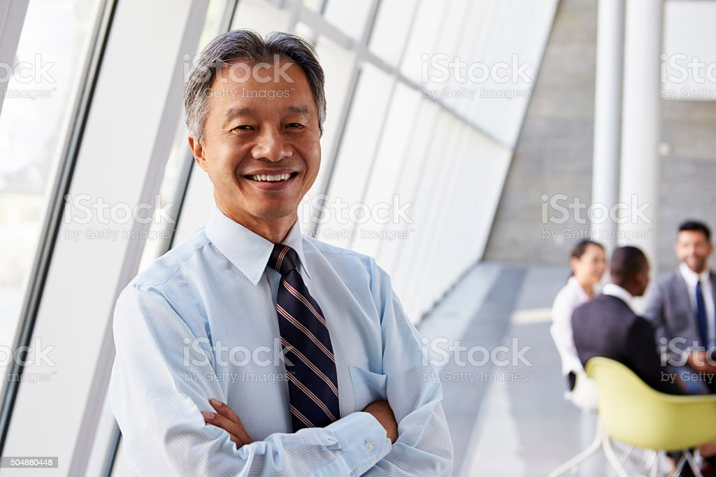 Portrait Of Asian Businessman In Modern Office stock photo