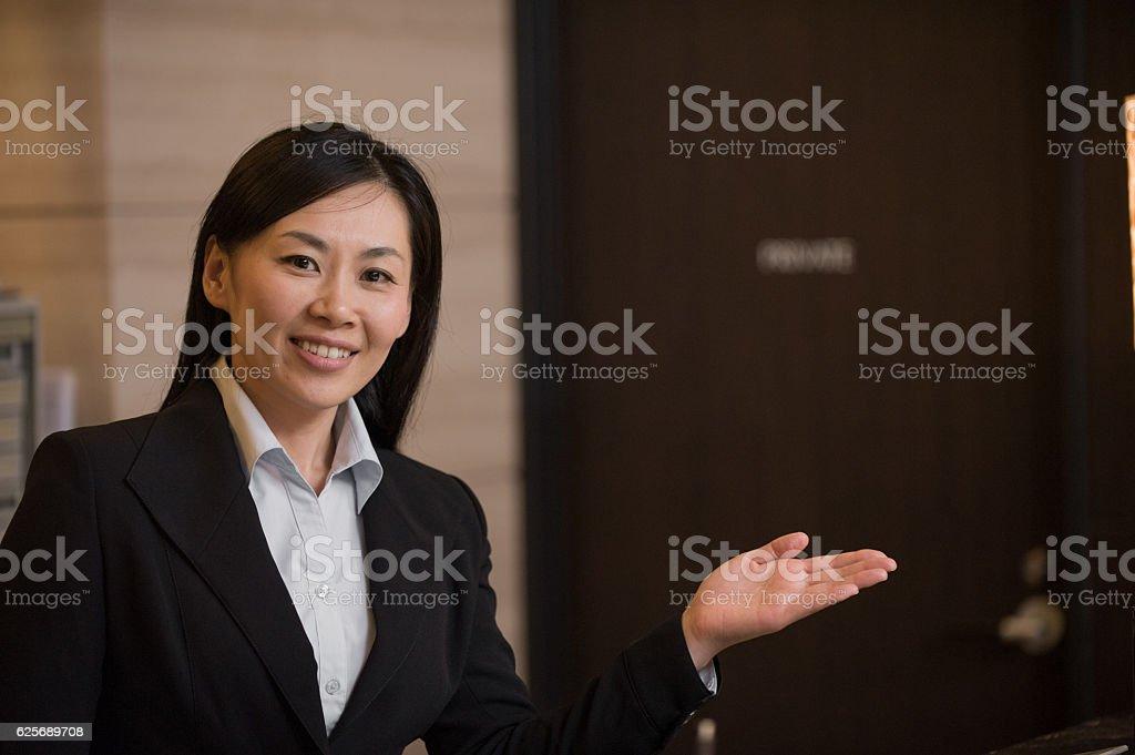 Portrait of Asian Concierge in Hotel stock photo
