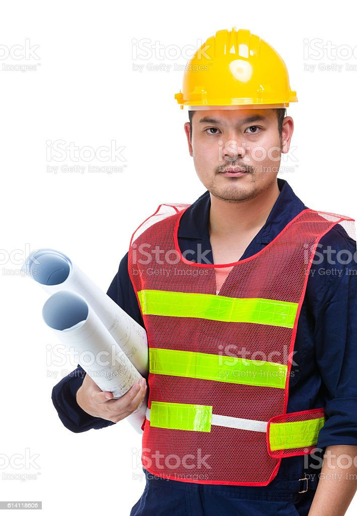 Portrait of Asian construction worker holding a drafting stock photo