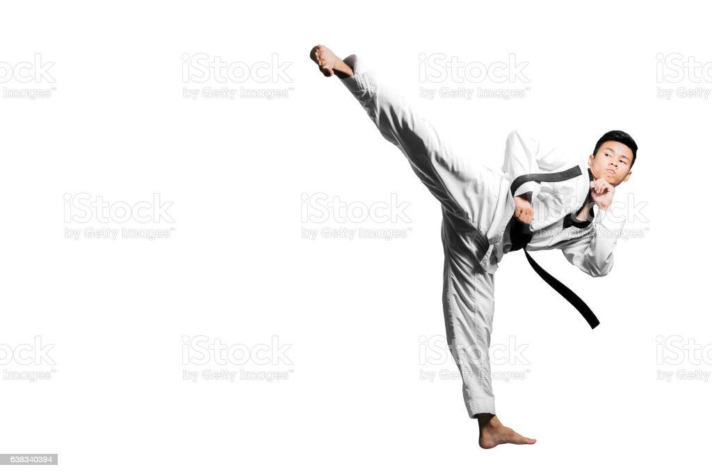 Portrait of asian man kick with taekwondo black belt stock photo