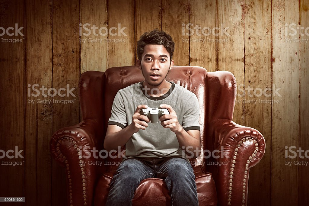 Portrait of asian man playing video games stock photo
