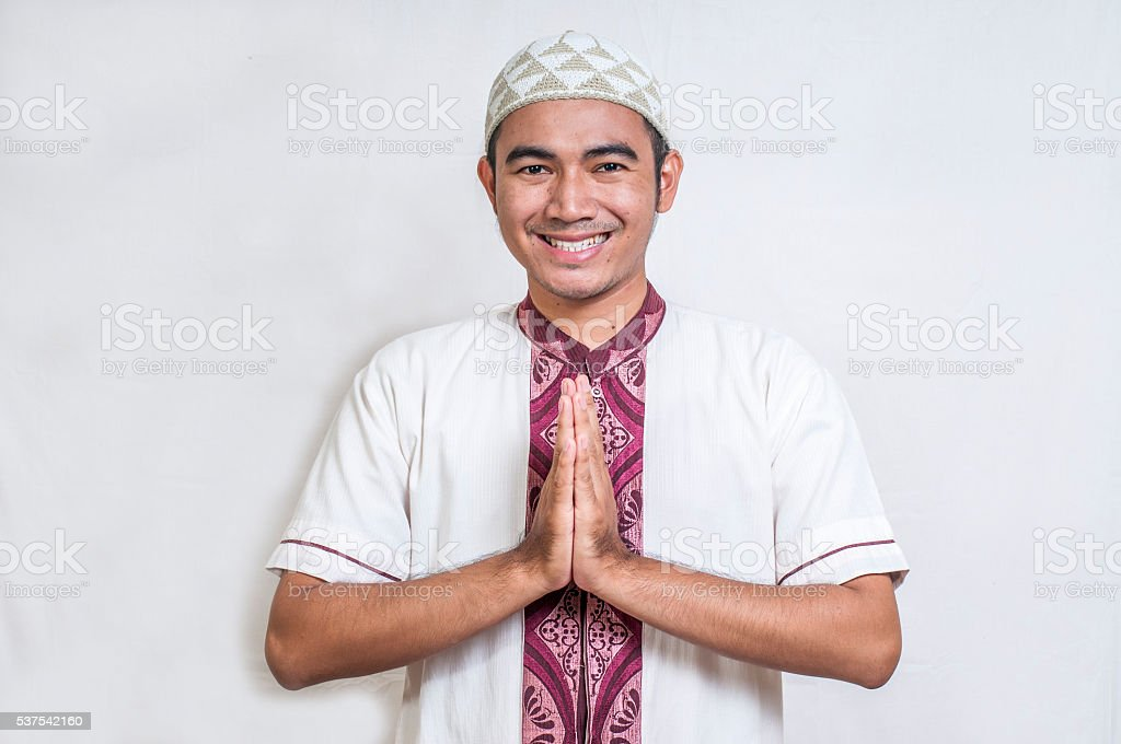 Portrait of Asian man with welcome gesture stock photo