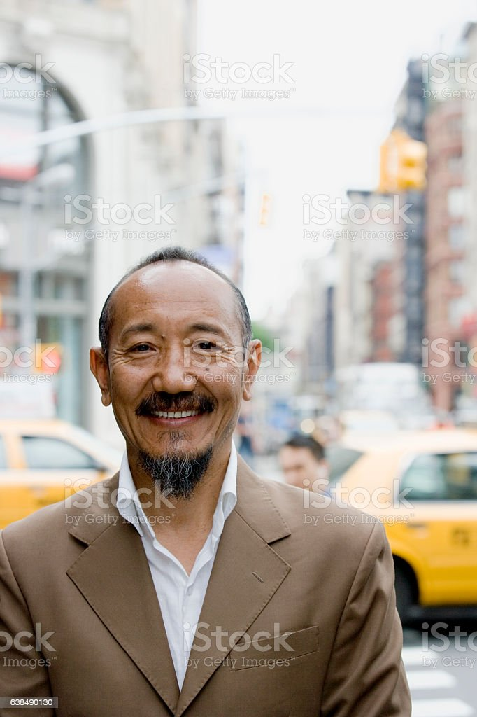 Portrait of asian mature man in downtown city stock photo