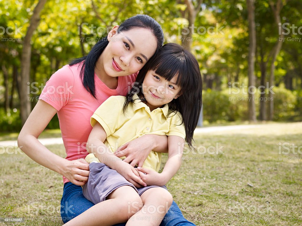 portrait of asian mother and daughter stock photo