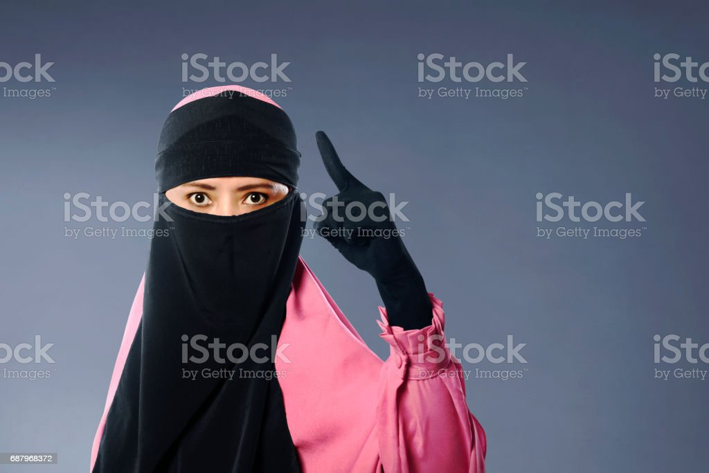 Portrait of asian muslim woman in veil with angry expression stock photo