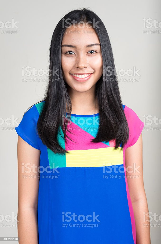 Portrait of Asian teenager girl smiling stock photo