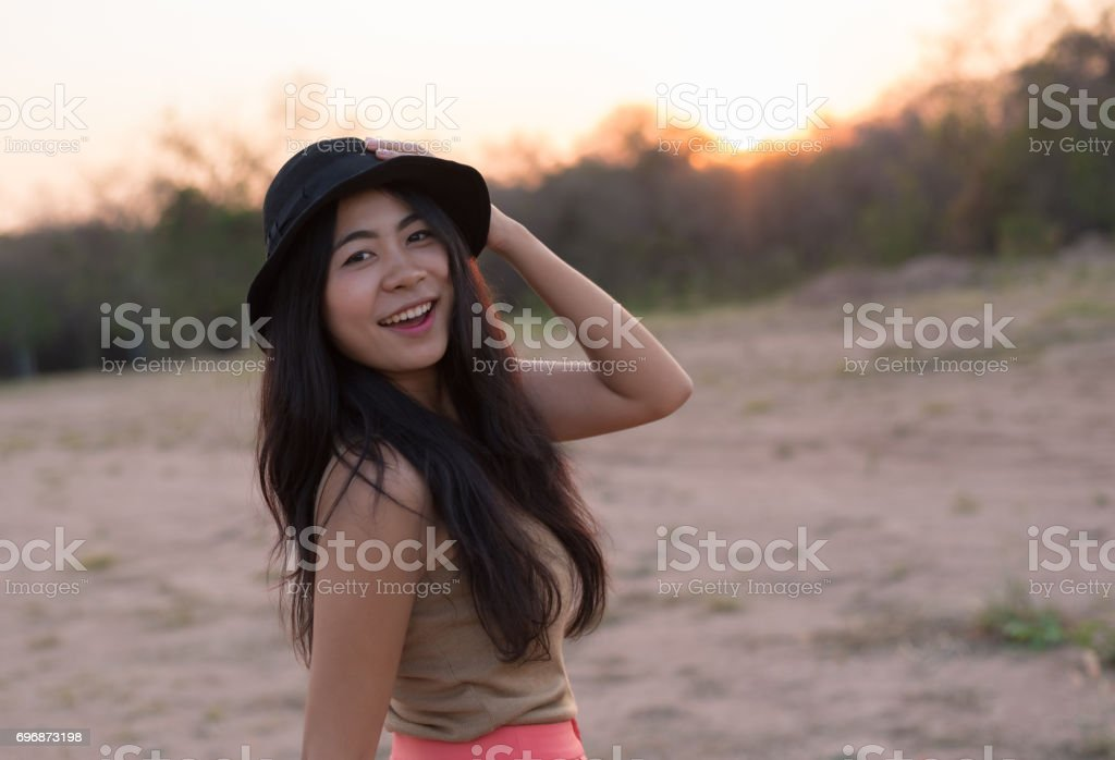 A portrait of Asian woman hipster travel with fashion vintage - stock photo