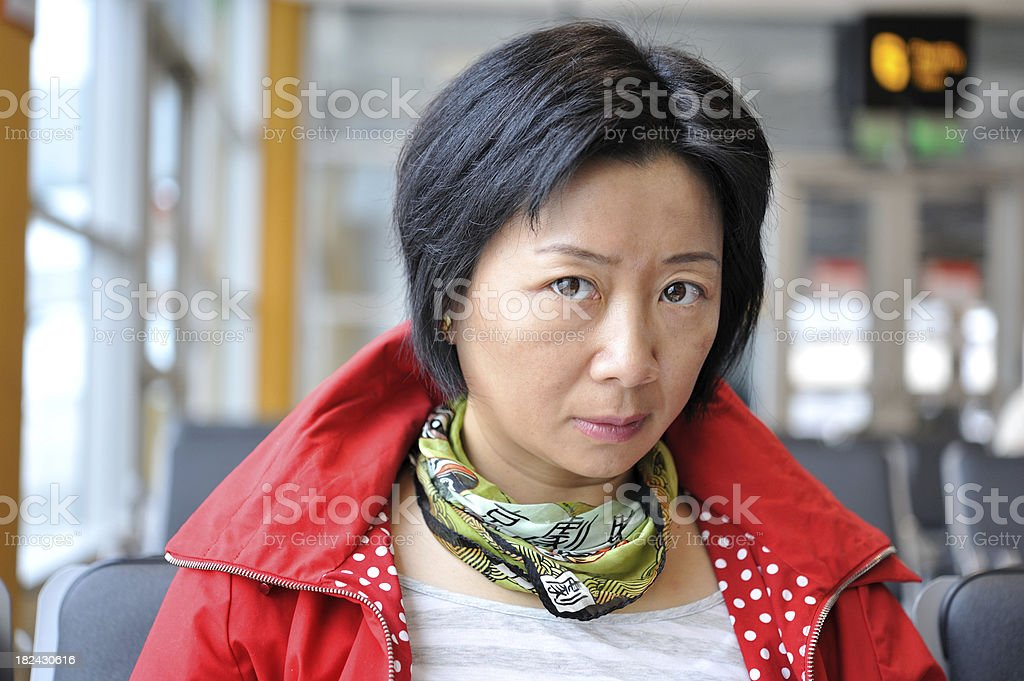 Portrait of Asian woman waiting at the airport. royalty-free stock photo
