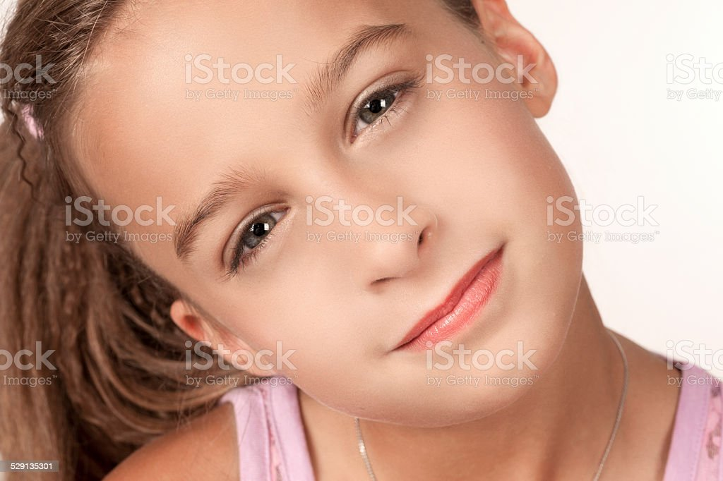 Portrait of attentive blonde young girl stock photo