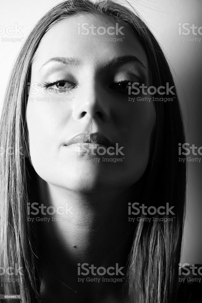 BW portrait of attractive brown-haired girl stock photo