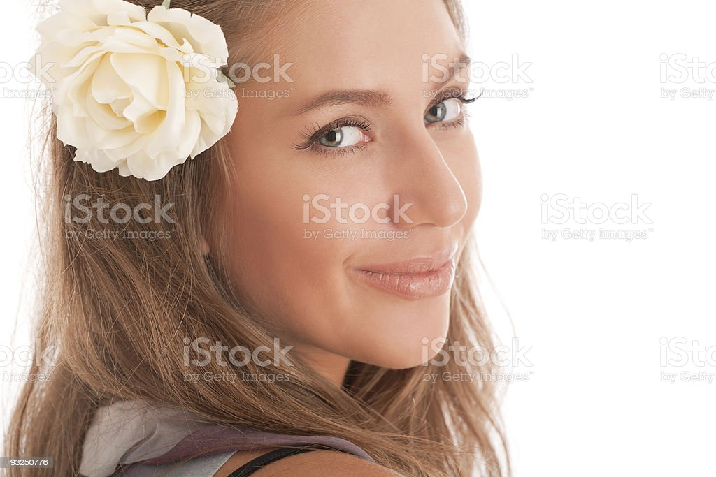 Portrait of attractive brown-haired girl with flower in hair royalty-free stock photo