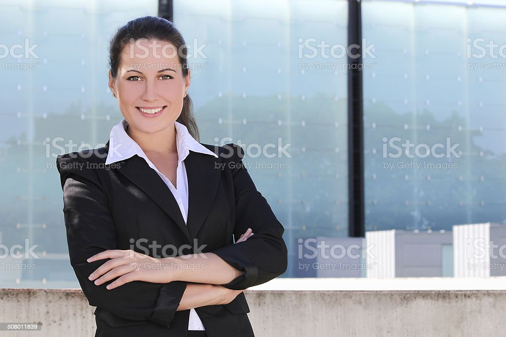 portrait of attractive business woman in the street stock photo