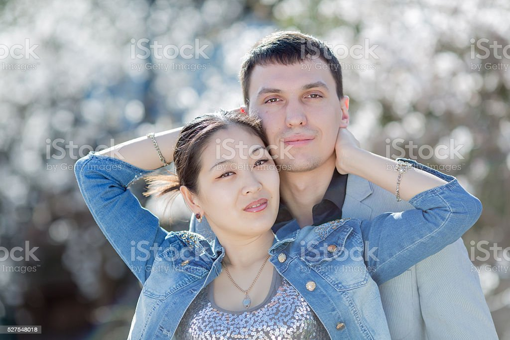 Portrait of attractive couple in blossoming park stock photo