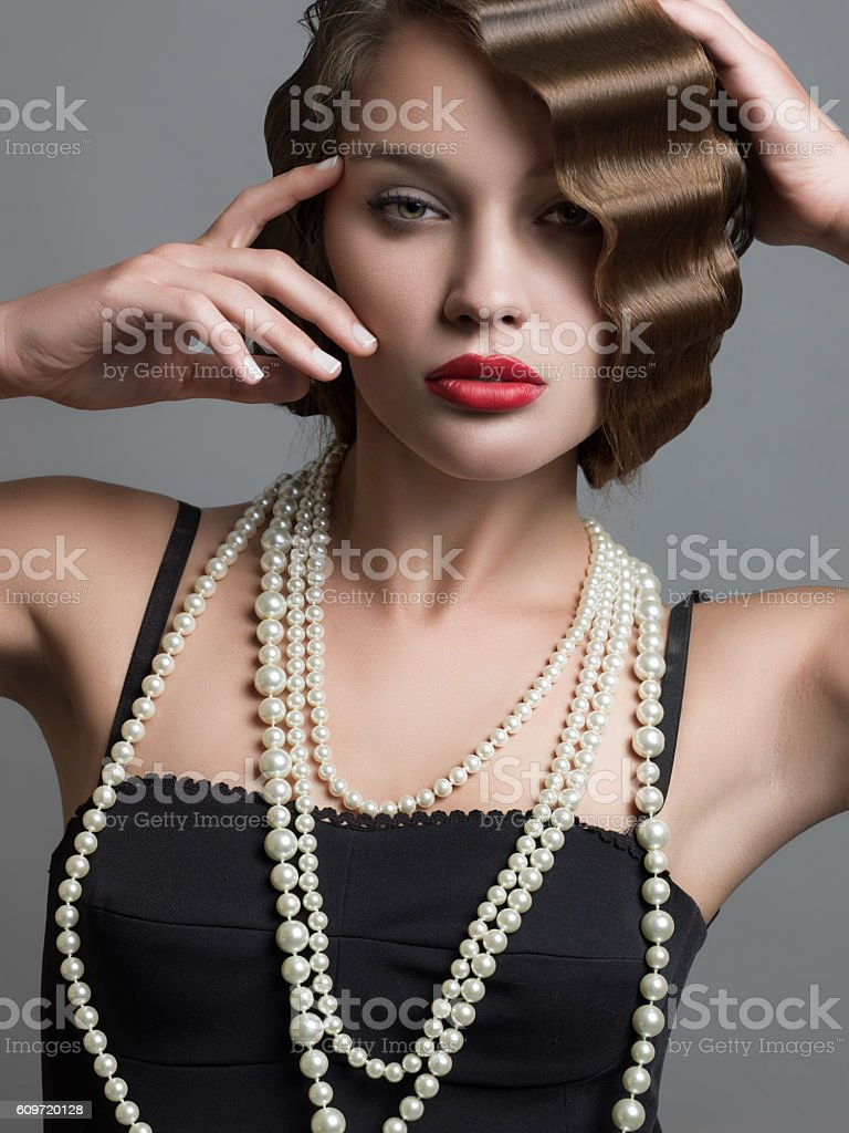Portrait of attractive female over gray background stock photo