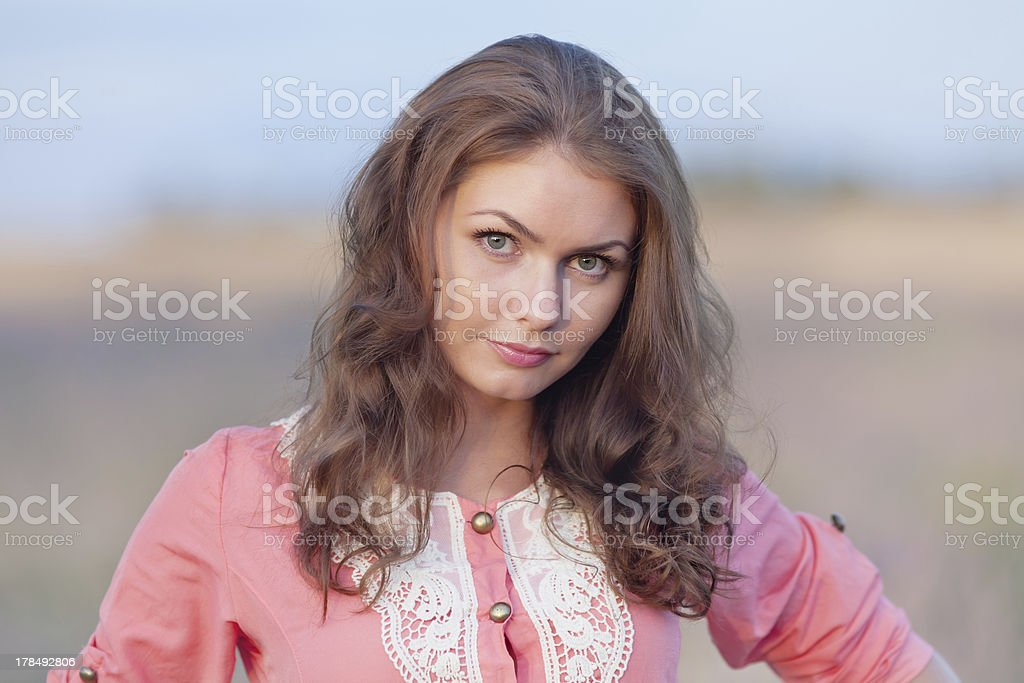 Portrait of attractive girl in pink dress royalty-free stock photo