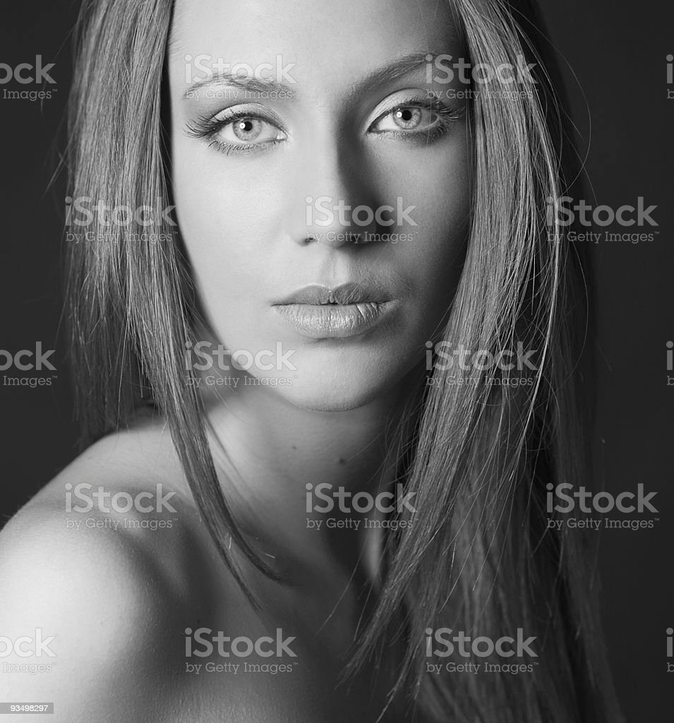BW portrait of attractive girl over black stock photo