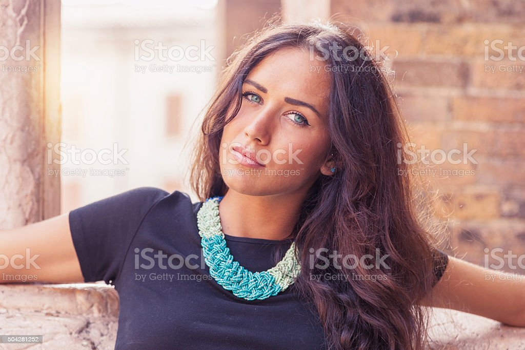 portrait of attractive girl posing in front of church stock photo