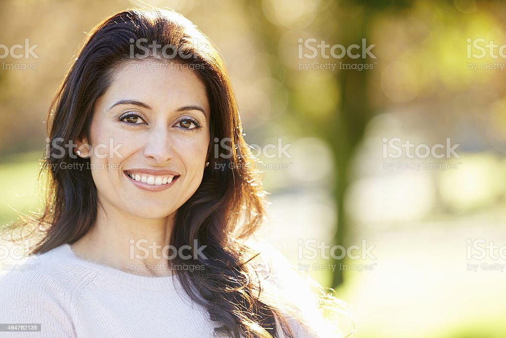 Portrait Of Attractive Hispanic Woman In Countryside stock photo