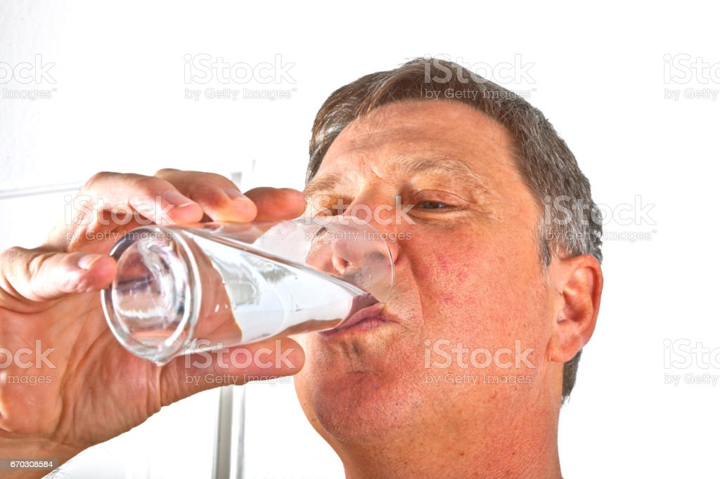 portrait of attractive man drinking water stock photo