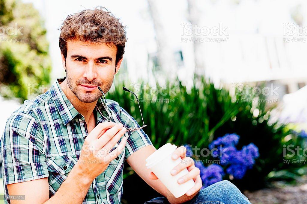 Portrait of attractive man in park stock photo